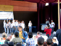 Group of Beautiful Girls coral singing in arabic. Group of Beautiful Girls singing choir coral in hejab and jeans, at charity event related USAID, at a camp to Royalty Free Stock Image
