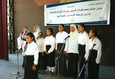Group of Beautiful Girls coral singing in arabic. Group of Beautiful Girls singing choir coral in hejab and jeans, at charity event related USAID, at a camp to Stock Images