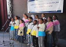 Group of Beautiful Girls coral singing. Group of Beautiful Girls singing choir coral in hejab and jeans, at charity event related USAID, at a camp to help Stock Photos