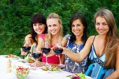 Group of beautiful girls drinking wine Stock Photo