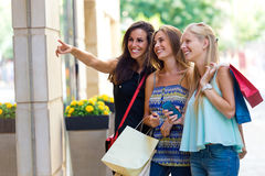 Group of beautiful girls looking at the shop window. Stock Image