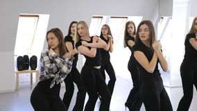 Group of beautiful girls stands in pose before starting to dance. stock video footage