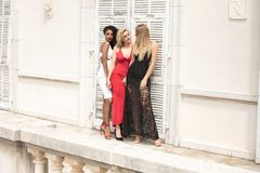 Group of beautiful ladies in elegant dresses at sunny summe. Group of beautiful ladies wearing elegant dresses. Girls having fun together, smiling. Two blonde stock images