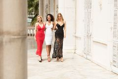 Group of beautiful ladies in elegant dresses at sunny summe. Group of beautiful ladies wearing elegant dresses. Girls having fun together, smiling. Two blonde royalty free stock images