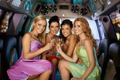 Group of beautiful smiling girls. Group of beautiful elegant smiling girls celebrating in limousine Royalty Free Stock Photo