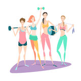 Group of Beautiful smiling young women standing holding fitness Royalty Free Stock Images