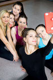 Group of beautiful sporty girls posing for selfie, self-portrait Stock Images