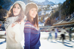 Group beautiful teenager girls ice skating outdoor at ice rink Stock Photos