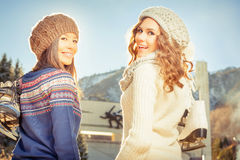 Group beautiful teenager girls ice skating outdoor at ice rink Royalty Free Stock Photos