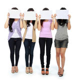 Group of beautiful women with blank paper Royalty Free Stock Photo
