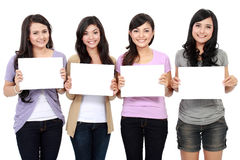 Group of beautiful women with blank paper Royalty Free Stock Image