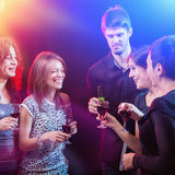 Group of beautiful young friends at the nightclub. Stock Image