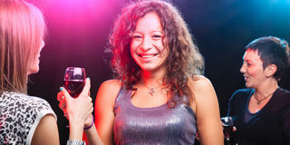 Group of beautiful young friends at the nightclub. Royalty Free Stock Photos