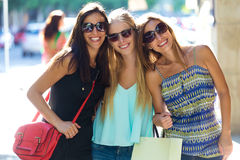 Group of beautiful young girls in the street. Shopping day. Outdoor portrait of group of beautiful young girls in the street. Shopping day Stock Images