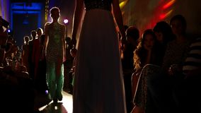 A group of beautiful young women in evening dresses stock video