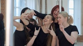 Group of beautiful young women taking a selfie after a pole dance class. Close up. Professional shot in 4K resolution. 087. You can use it e.g. in your royalty free stock photos