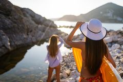 Group of beautiful young women friends walking on the beach. Group of beautiful young women walking on the beach stock image