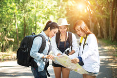 Group of beautiful young women walking in the forest,. Enjoying vacation, travel concept stock image