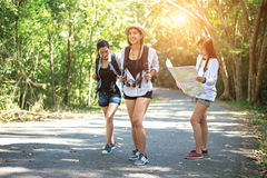 Group of beautiful young women walking in the forest, enjoying vacation,. Travel concept stock photography