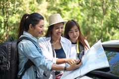 Group of beautiful young women walking in the forest,. Enjoying vacation, travel concept royalty free stock images