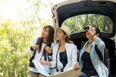 Group of beautiful young women walking in the forest, enjoying vacation,. Travel concept royalty free stock image