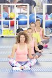 Group of beautiful young women working out. At the gym stock photo