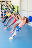 Group of beautiful young women working out on TRX. Group of beautiful young women working out on TRX and smiling royalty free stock photography