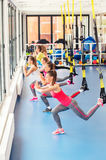Group of beautiful young women working out on TRX. Group of beautiful young women working out on TRX and smiling royalty free stock images