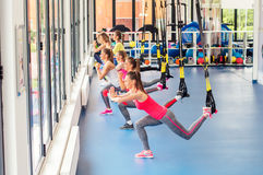 Group of beautiful young women working out on TRX. Group of beautiful young women working out on TRX and smiling stock images