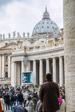 A group of believers in St. Peter's Square Stock Photo