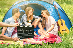 Group of best friends camping in the park Royalty Free Stock Image