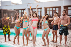 Group of best friends having fun at swimming pool Stock Image