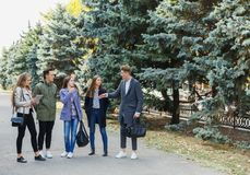 A group of best friends together and walk in the park. Friends all have a good time and smile. Concept of leisure Royalty Free Stock Photography