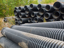 Group of big  corrugated pipes made of black plastic Royalty Free Stock Photo