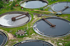 Group from the big sedimentation drainages. Round form. Water settling, purification in the tank by biological organisms on the water station Stock Photo