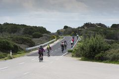 Group of bikers on maddalena island. Maddalena,Italy,07-April-2018:Group of bikers on maddalena island, this island is next to sardinia island and fomous of its Royalty Free Stock Image