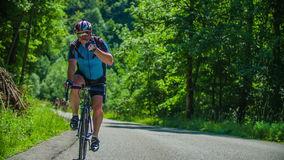 Group of bikers racing in marathon throught beautiful landscape in Slovenia