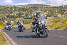 Group of bikers riding Harley Davidson. Biker rides Harley Davidson motorbike with a group of bikers at motorcycle rally Sangiovese tour by Ravenna Chapter on Stock Images