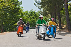 Group of bikers riding a vintage italian scooters Stock Photos