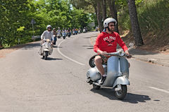 Group of bikers riding a vintage italian scooters Royalty Free Stock Images