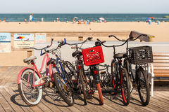 Group of bikes on boardwalk at beach Royalty Free Stock Photography