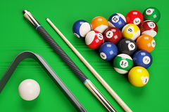 Group of billiard colored balls, cues and triangle Stock Photos