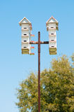 Group of bird houses on a pole Stock Image