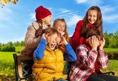 Group of birls surprising boys Royalty Free Stock Photography