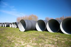 Group of black big pipelines Stock Photos