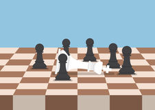 Group of black chess pawns defeat the white king Royalty Free Stock Photo