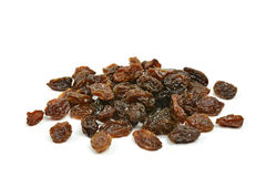 Group of black raisins on a white background Royalty Free Stock Photography