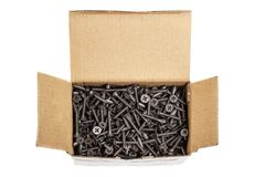 Group of black screws in a box. Group of black screws for fixing drywall on metal profiles, in a paper box Stock Photography