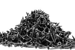 Group of black screws. For fixing drywall on metal profiles Stock Photos