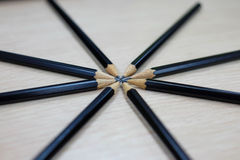 Group of black wooden pencils. On wooden table Royalty Free Stock Photography